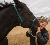 Barrel racer Jodie Davis,17, gets a kiss from her horse Pageant at the Keystone Centre on Friday, Sept. 28. (Chelsea Kemp/The Brandon Sun)